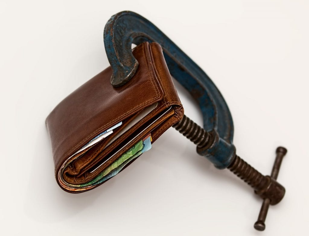 cost-of-living adjustment: wallet in vise
